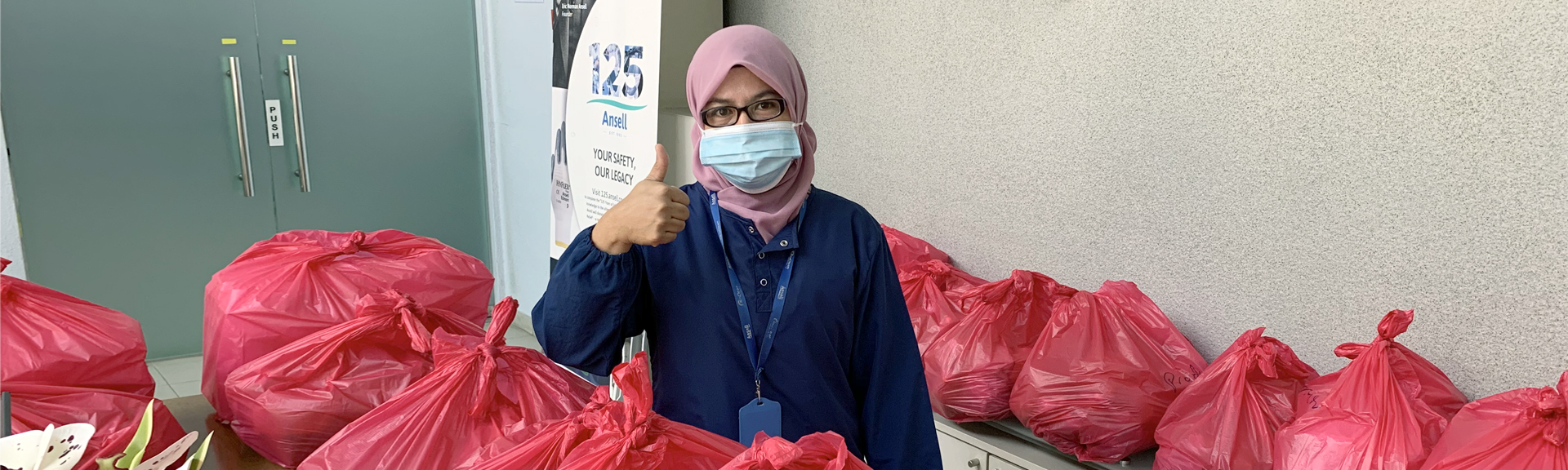 ansell employees in masks donating products to a healthcare center