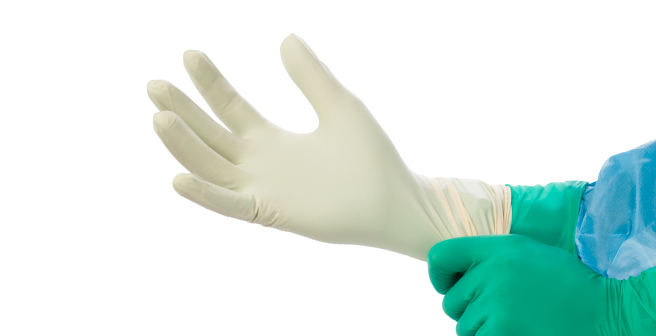 Double donning a disposable glove