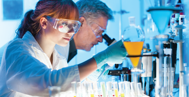 Technicians in Lab with Dramatic Lighting Stock Photo