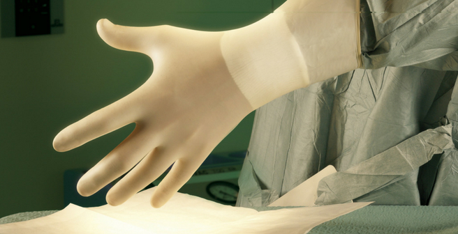 GAMMEX Latex Moisturizing Hospital Application - Medical Professional Donning Glove