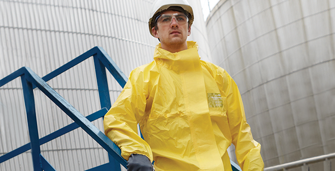 Refinery worker wearing yellow alphatec suit